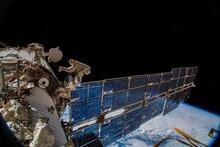 The cosmonauts Oleg Artemyev and Sergey Prokopyev installing an antenna on the International Space Station in 2018 to track animal movements on Earth.Credit...A. Gerst/ESA/NASA